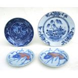 A Chinese blue & white charger decorated with precious objects beside a tree, 32cms (12.5ins)