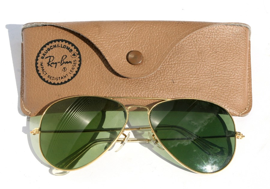 A pair of Bausch & Lomb Ray-Ban USA Aviator sunglasses, cased, unusually having etched mark to the
