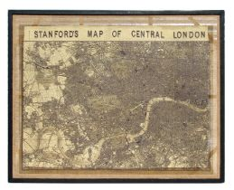 A large print of Stanford's Map of Central London, framed and mounted on hessian, overall 103 by