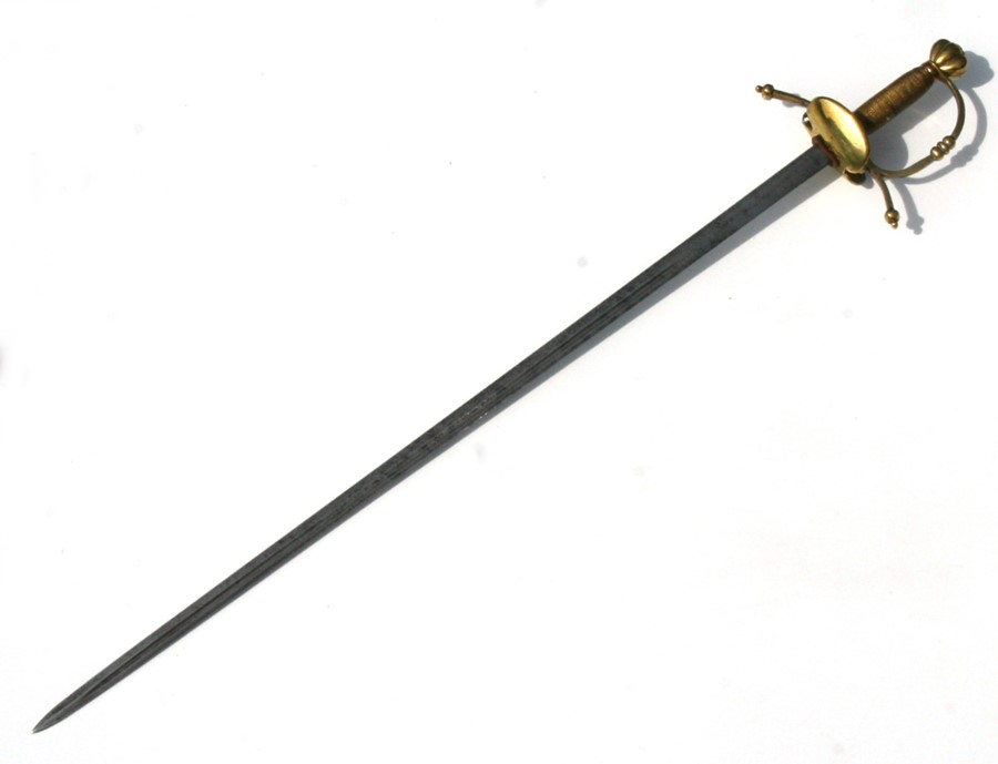 A Rapier type sword with brass hilt, the blade cut with single offset fullers, the hilt with down