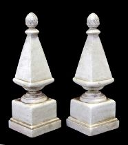 A pair of painted stone effect garden obelisks with pineapple finials, 40cms (15.75ins) high.