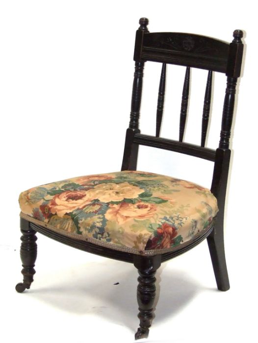 A late 19th century ebonised Godwin style design nursing chair with upholstered seat, on turned