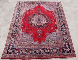 A Persian Meshed hand knotted wool carpet with central foliate design within foliate borders, on a