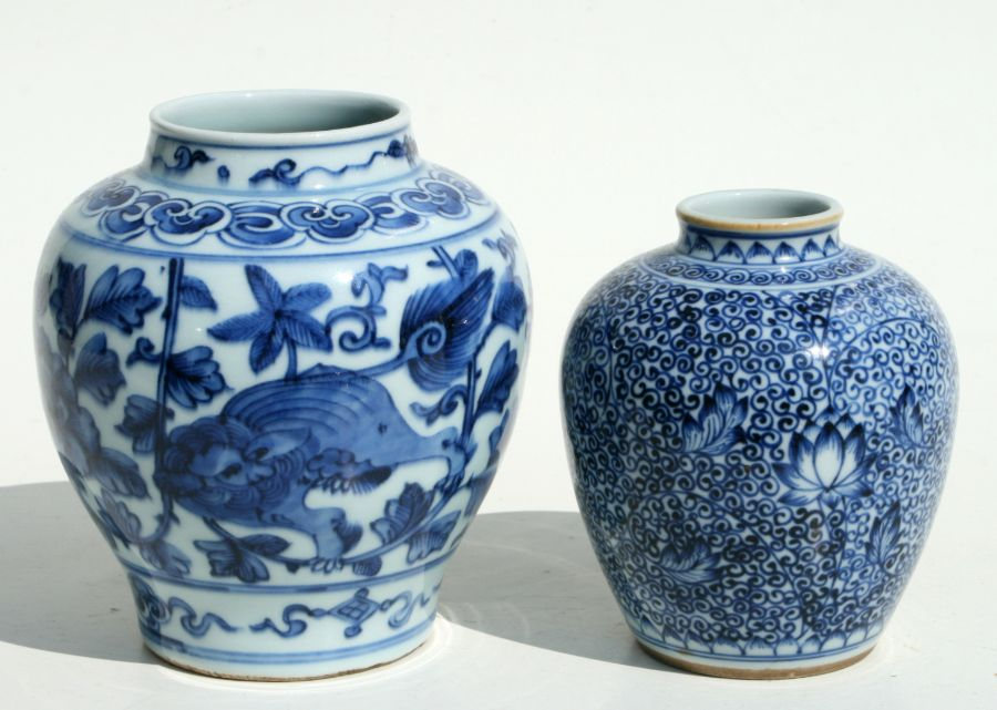 A Chinese blue & white vase decorated with shi shi amongst flowering scrolling foliage, 15cms