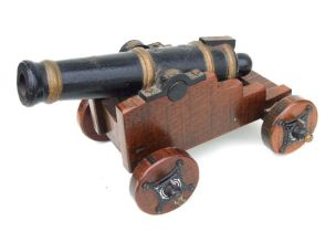 A 19th century cannon. Having a cast iron barrel 49cms (19.25ins) long with the vent hole being