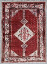 A fine quality Persian Arak rug, the central gul with figures, animals and buildings, on a beige