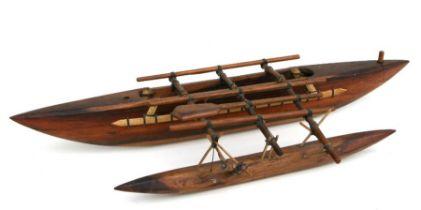 A wooden model of a Kiribati outrigger Pacific Ocean boat, 74cms long.