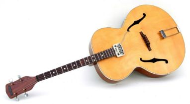 A 1950's Hohner Berkeley Tenor F hole acoustic guitar with Ideal electric pick up, cased.Condition