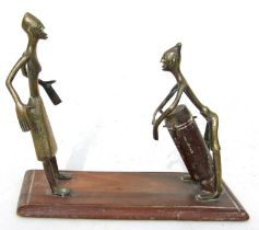 A pair of African tribal bronze / brass figures, one playing a drum, mounted on a hardwood base,