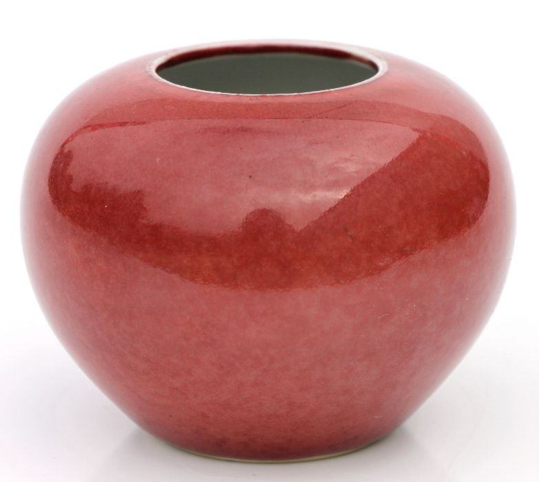 A Chinese red glazed brush washer of compressed globular form, 6cms high.Condition ReportVery