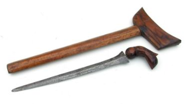 An Indonesian Kris in its wooden scabbard. Blade length 31cms (12.25ins)