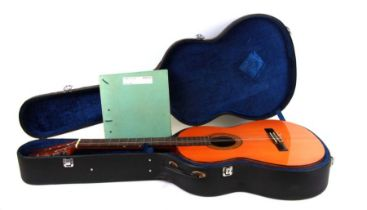 A vintage Spanish made Alhambra Classical guitar in a hard case, model 4C; together with sheet music