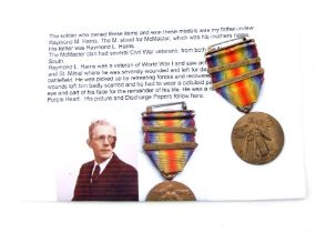 A WWI USA Victory Medal with Defensive Sector & St Mihiel clasps awarded to Raymond L Harris with
