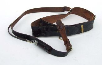 An officers black leather Sam Browne belt with cross strap and military marked whistle
