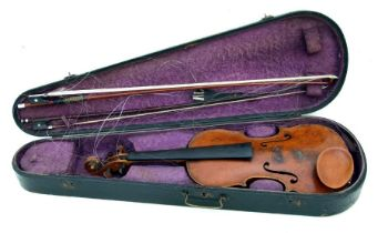 A one-piece back violin, overall length approx 60cms; together with two bows, in an ebonised pine
