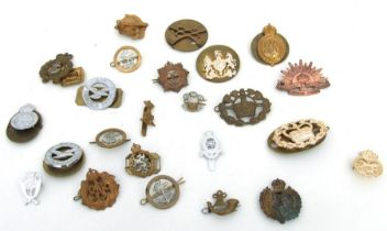 An assortment of 27 Army, Navy & Air Force badges
