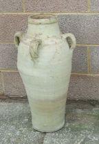 A large four-handled terracotta olive jar, 77cms high.