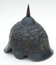 An unusual reproduction 19th century military spiked metal helmet with VR cypher badge