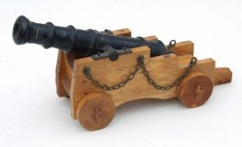 A large desk top signal cannon. Having a cast iron barrel 31cms (12.25ins) long with an