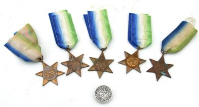 Five WWII Atlantic Star medals together with a For Loyal Service lapel badge