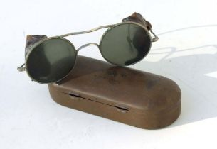 A pair of RAF Air Crew anti glare glasses in an Air Ministry tin marked with name and service number