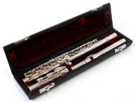 A John Packer Ltd three-piece silver plated flute, cased.