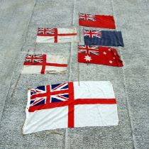 A Royal Navy White Ensign flag, 136 by 68cms; together with other flags.