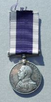 A Royal Navy Long Service Good Conduct Medal named to J.59057. A.E.SMITH. OFF STW.2CL. HMS. DELHI.