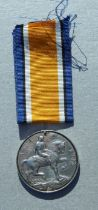 A WWI Royal Navy War Medal (no ribbon suspender) named to K54422 STO. FRED COOPER. R.N.
