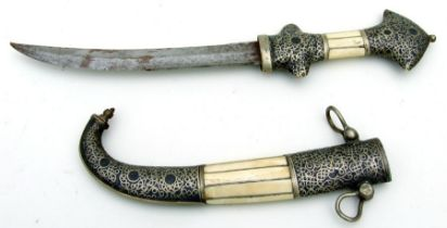 A good quality middle eastern jambiya dagger with bone inlay to the hilt and scabbard. Blade