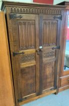 OAK WARDROBE WITH CARVED PANELS, IN THE STYLE OF OLD CHARM