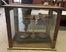 A set of laboratory scales in glass case