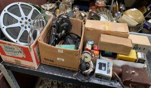 Half shelf of early collectable cine equipment to