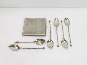 A silver cigarette case, 127 grams gross; with fiv
