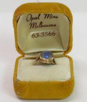 An opal triplet set ring, stamped '9ct', finger si