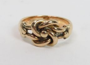 An 18 carat gold knot ring, London 1919, finger si
