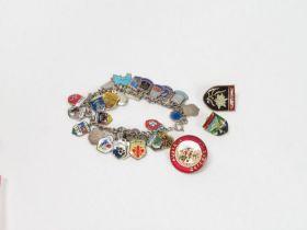 A charm bracelet with various enamel souvenir