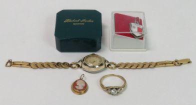 A 9 carat gold three stone ring; a cameo pendant;