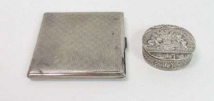 A small circular silver box, with 1912 Chester imp