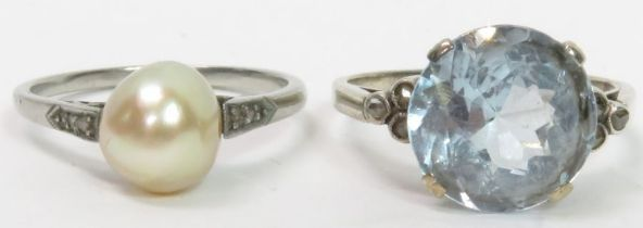 A synthetic blue spinel ring, with a trio of rose
