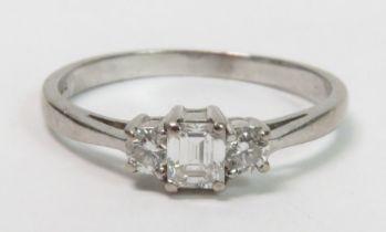 An 18 carat white gold three stone diamond ring, t
