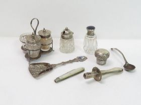 A small silver cruet frame with a glass salt, and
