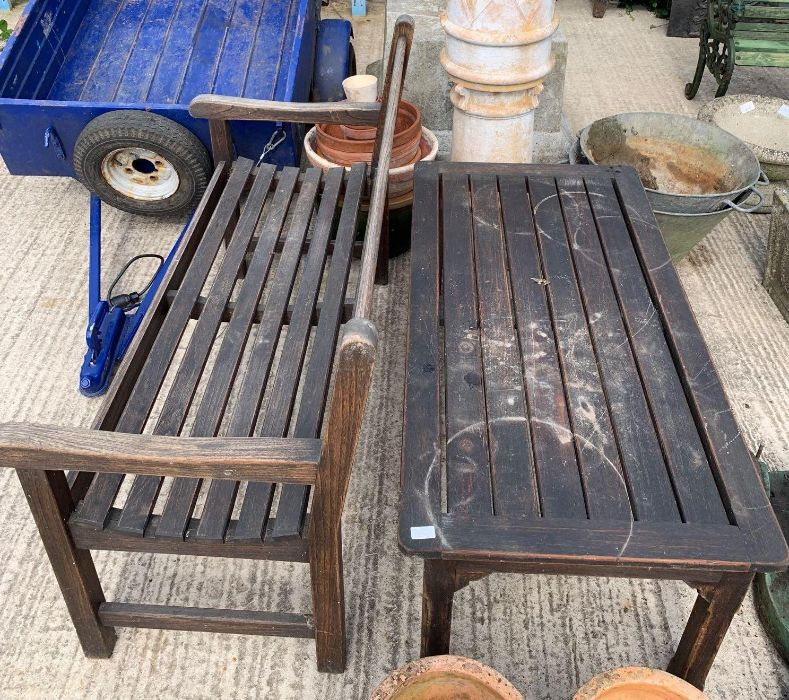 Wooden garden bench with matching table