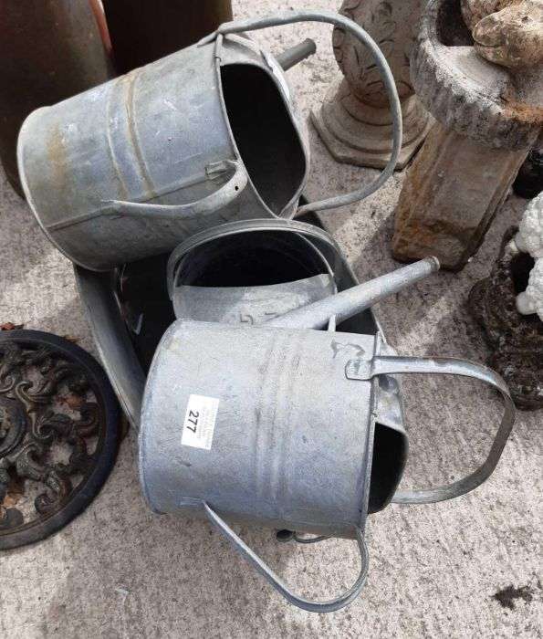 3 galvanized watering cans & a galvanized tub