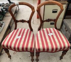 Pair of stained oak dining chairs with striped uph