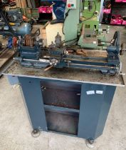 Lathe with cabinet below & box of assorted accesso