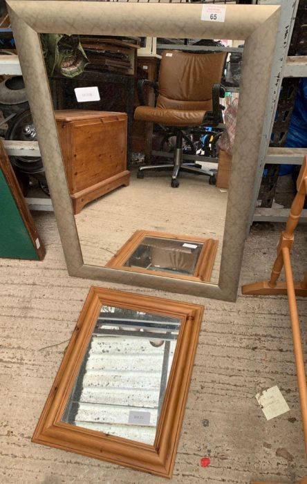 Silver framed wall mirror together with a smaller