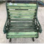 Green painted garden chair with green painted meta