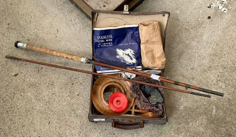 Vintage suitcase containing large wooden reel of f