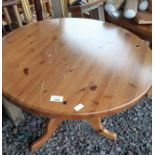 Round pine kitchen table & a pine occasional table